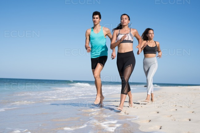Young woman winning the beach reac