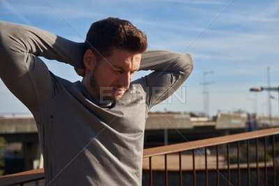 Man holds his arms above his head