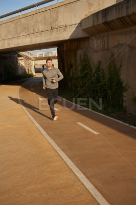 Man running along an athletic track