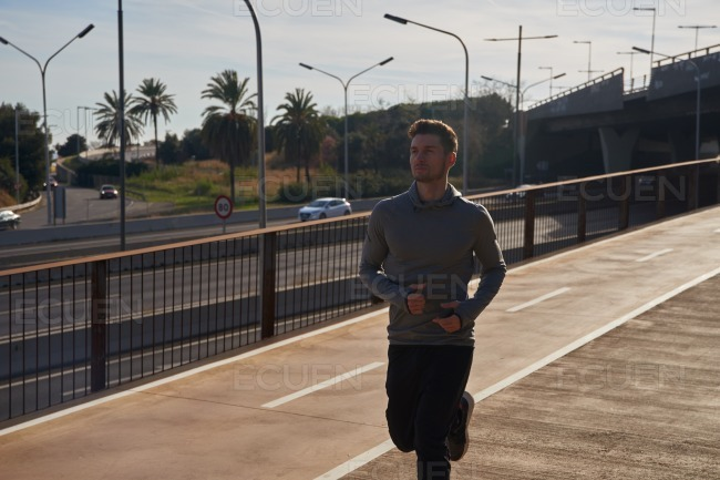 Man running on the side of a motorway