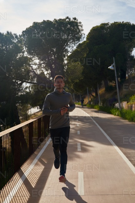 Young man jogging on a path