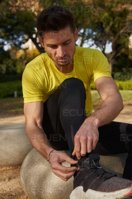 Young man preparing to go running