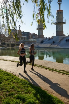 Women running along a paved path