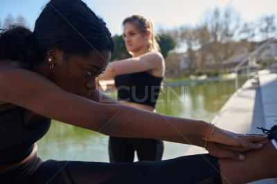 Young women doing stretching training exercises