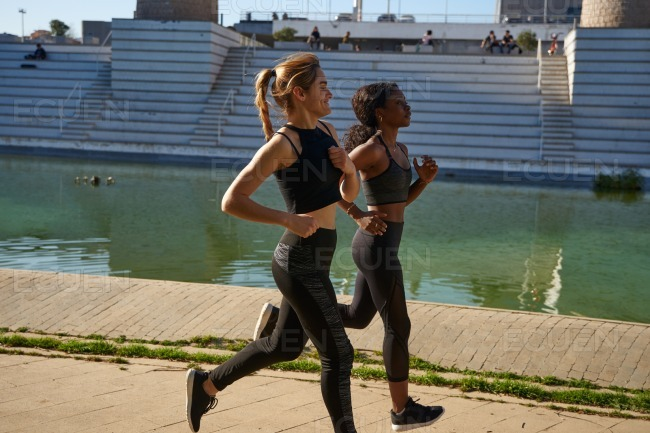 Women running in an athletic park stock photo