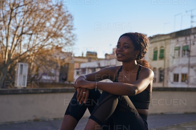 Young woman sitting on the ground stock photo