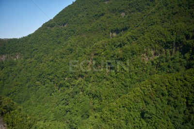 Gentle sloped mountain side, with blue sky