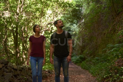 Man and woman walking in a forest