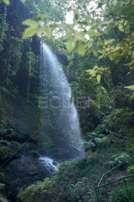 Waterfall cascading over a mountain side