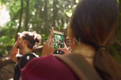 Woman taking a picture of a man