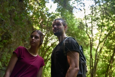 Young couple looking ahead in a forest