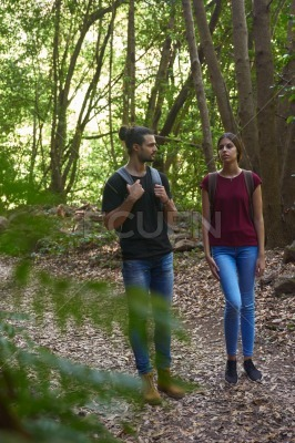 Young couple strolling in the forest