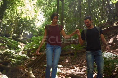 Young couple strolling in the woods