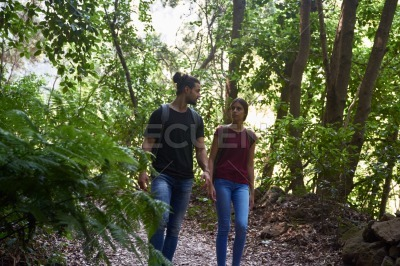 Young couple walking through a forest