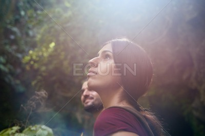 Young woman looks up at the skyline
