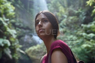 Young woman stand pensively looking at the camera