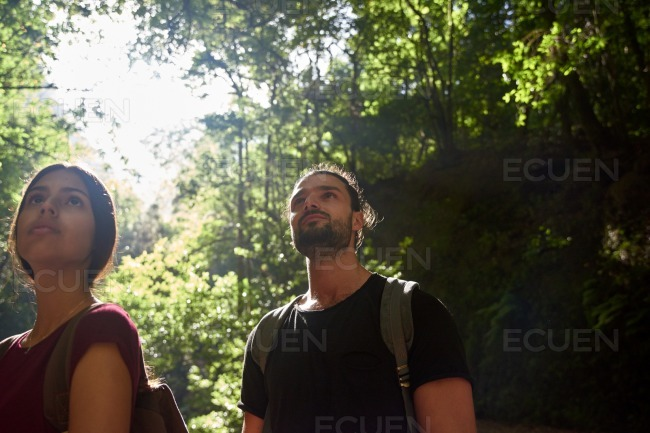 Couple looking up as they observe their surrounds stock photo
