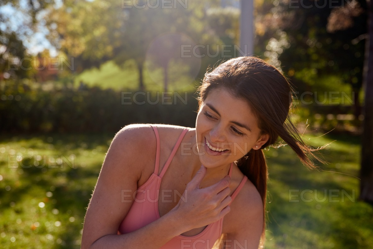 Smiling young woman leans to the side stock photo