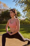 Woman doing a leg lunge in the park