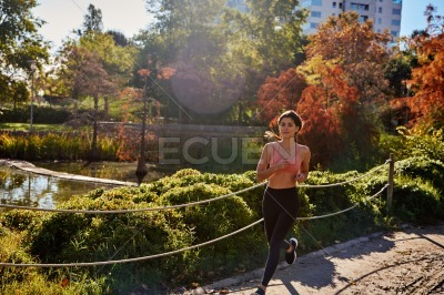Attractive young woman running in the park
