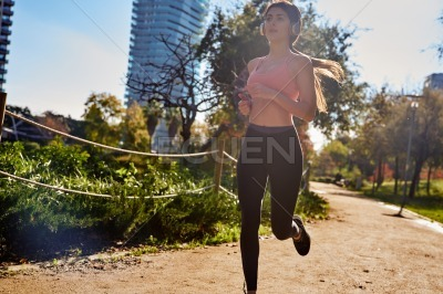 Brown haired woman running in the park