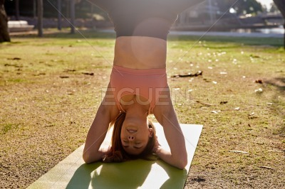 Close up of a woman doing a supported head stand