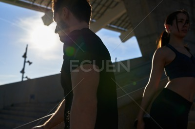 Couple stretching their muscles together outdoors