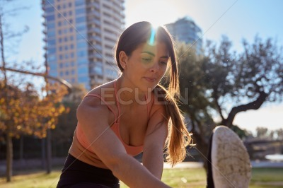 Dark haired woman stretches in exercise