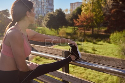 Woman looks up at the skyline as she stretches