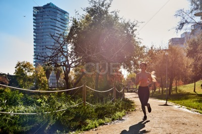 Woman running around a path in the park
