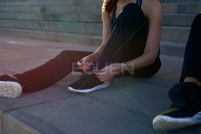 Woman tying her running shoe lace