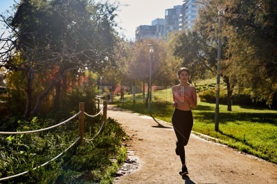 Woman with headphones running in the park