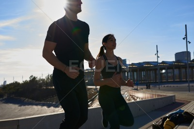 Young couple jogging in the day