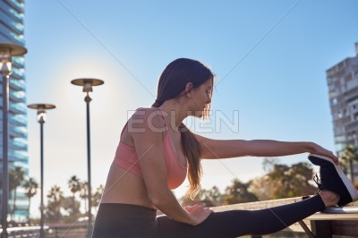 Young woman with her leg raised in exercise