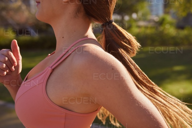Close up of a brain haired woman running