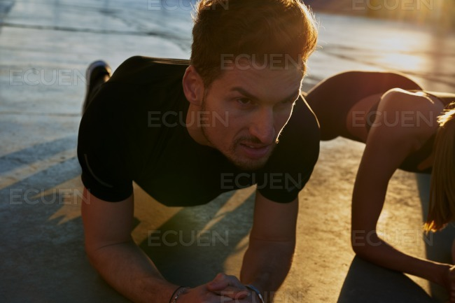 Man leaning forward doing a push up stock photo
