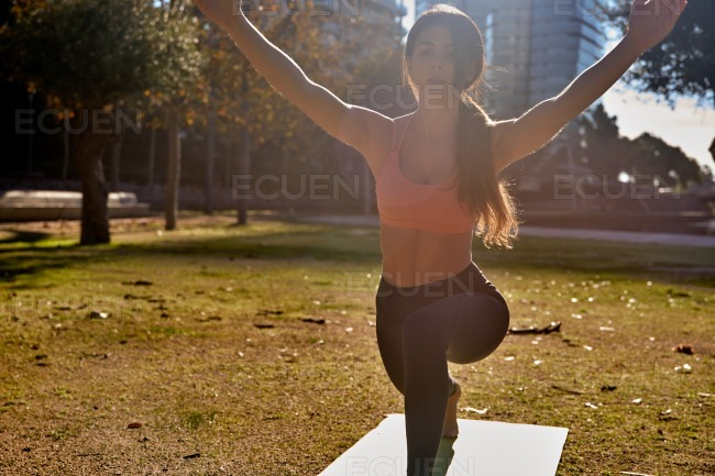 Woman does a forward lunge with arms raised