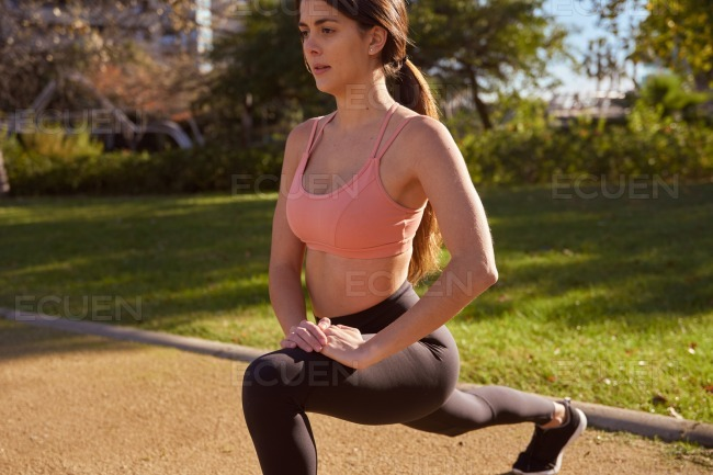 Young woman doing exercises in the park