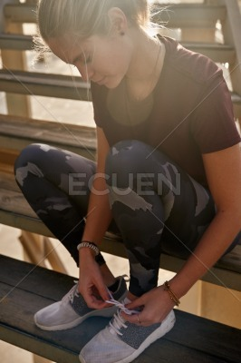 Close up of a woman tying her shoe laces