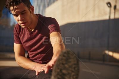 Close up of a man reaching for his feet