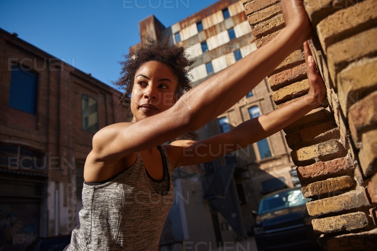Fit young woman looking away thoughtfully outdoors stock photo
