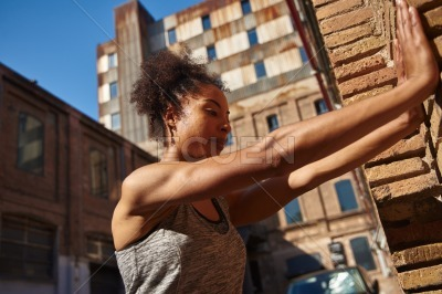 Attractive young woman doing wall push ups