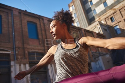 Attractive young woman working out in the city