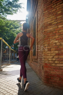 Dedicated young woman jogging in the city