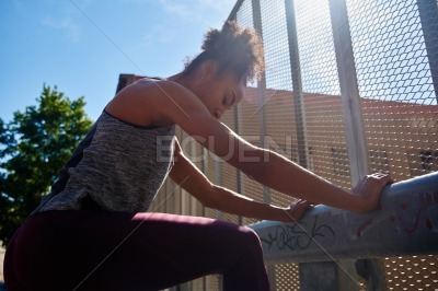 Fit young woman doing exercises on a sunny morning
