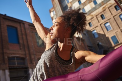 Fit young woman exercising alone in the city