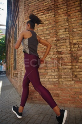 Fit young woman jogging in the city