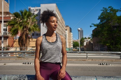 Sporty black woman looking away thoughtfully
