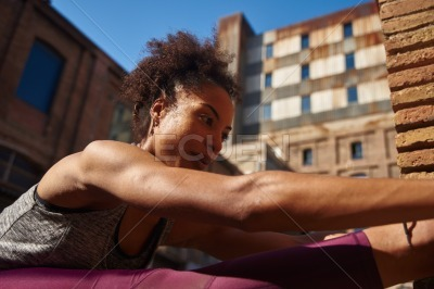 Sporty young woman exercising in the city