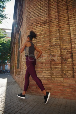 Sporty young woman jogging in the city